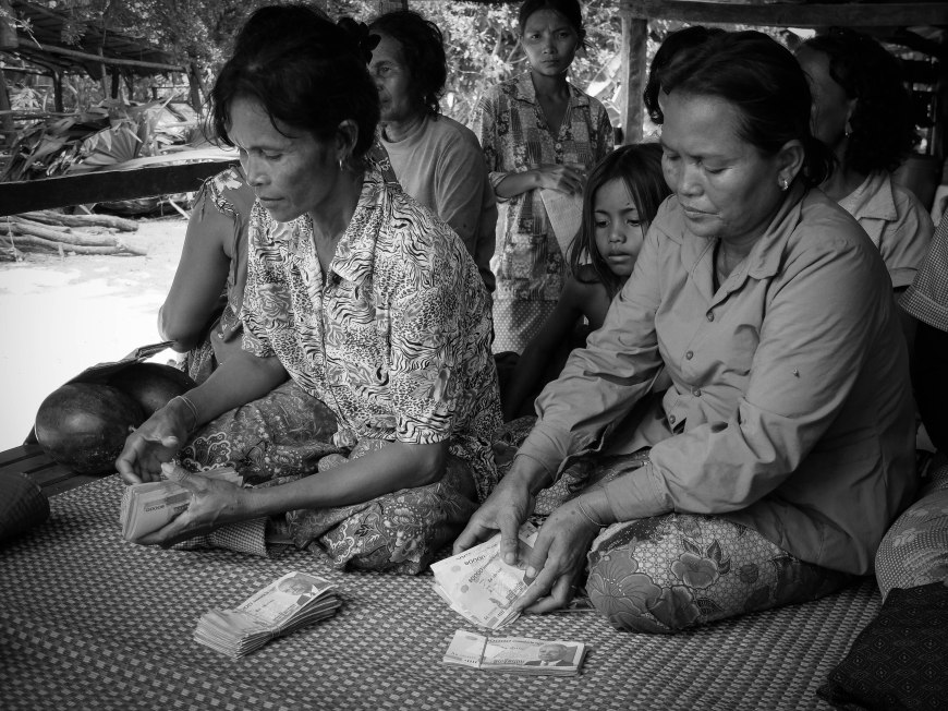 Microfinancing in action - the women counting the money they have borrowed.