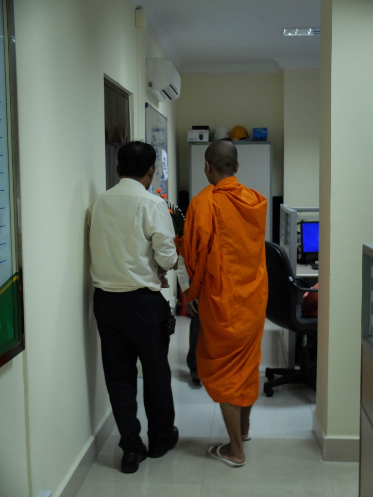 Getting my desk blessed by the Monk - now that's a zen workplace!