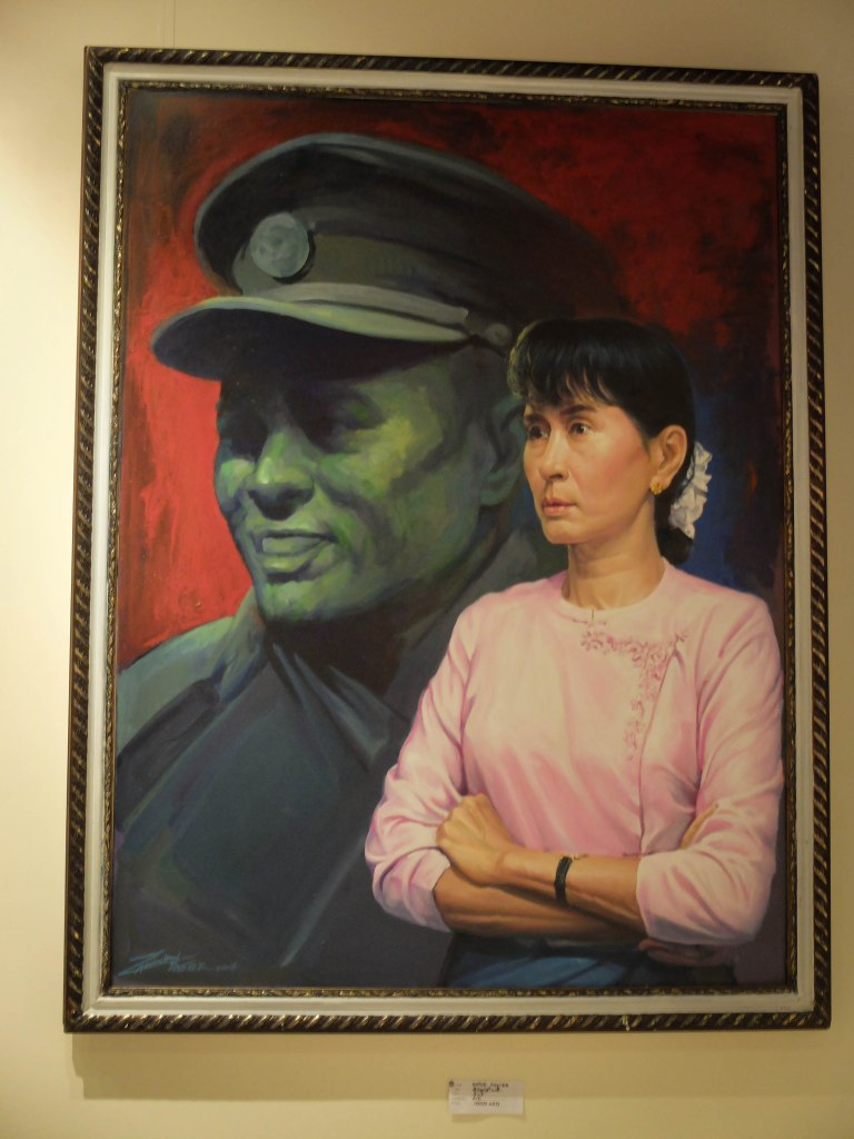 Aung San Suu Kyi and her father captured in a painting by a local artist.